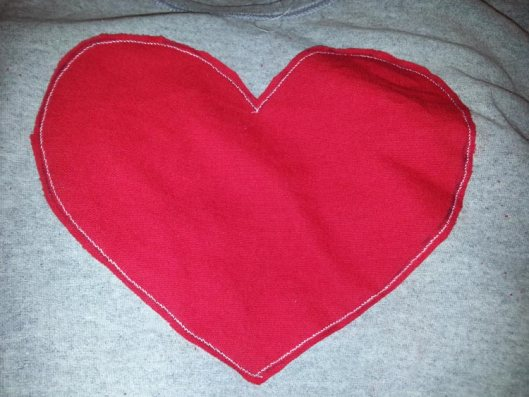 Refashion a Faded T-Shirt Into a Heart Cut-Out for Valentine's Day - Refashion / upcycle those t-shirts with a a few snips and lace for the day of love. Step-by-step DIY sewing tutorial for upcycling clothes into some other type of clothing or accessory. Remake, redo, reuse, and recycle to help save money and save the planet. Explore the web site for more refashioning tutorials, dozens of cute refashionista and fashion ideas with good, clear photos and instructions. http://letgoofbeingperfect.com/